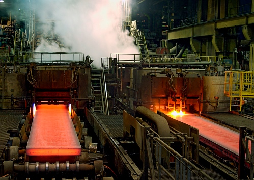 Steel exits the caster at ArcelorMittal Dofasco's continuous casting facility in Hamilton, Ont.