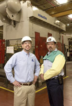 Arvin Sango Inc.39s plant manager Scott Hubbard (left) and production manager Randy Lockridge stand in front of the company39s 2,000-tonne steel press designed for stamping auto parts.