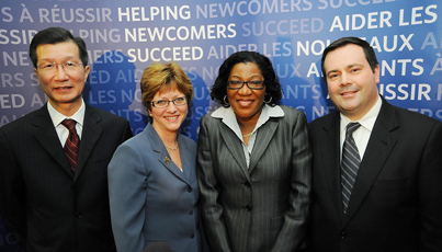 From left to right: Michael Chan, Ontario Minister of Citizenship and Immigration; Diane Finley, Minister of Human Resources and Skills Development; Kay Blair, executive director of the Community MicroSkills Development Centre in Toronto; and Jason Kenney, Minister of Citizenship, Immigration and Multiculturalism.