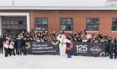 Garant's employees celebrating the 125th anniversary of the company with Bonhomme. Photo: DanielTphoto (CNW Group/Garant)